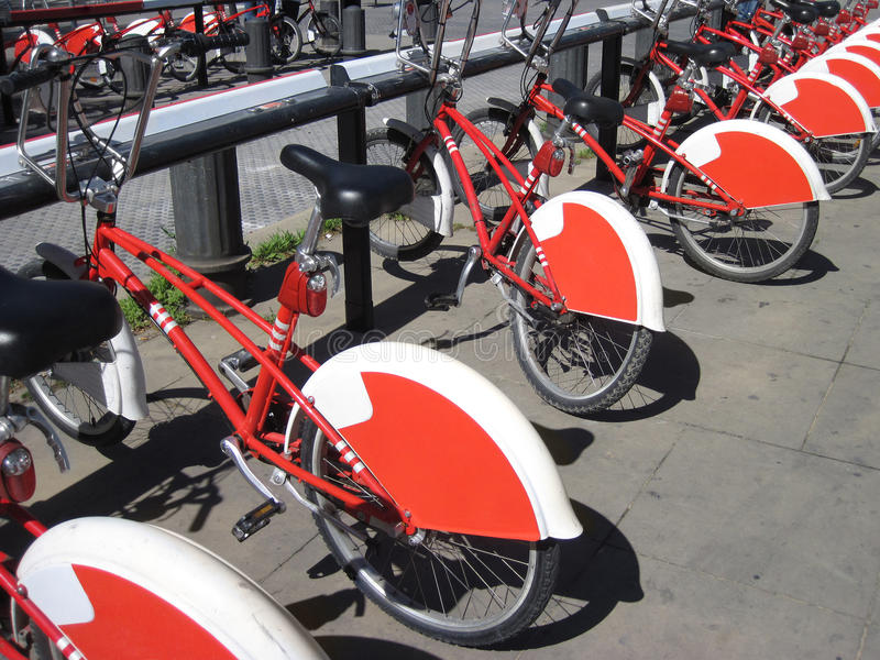 Bike Sharing in Barcelona, Spain. Long row of red and white public bikes stock images
