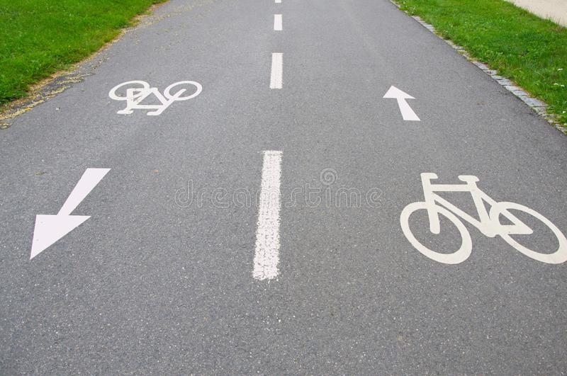 Bike signs with arrows on the road showing opposite directions stock photo