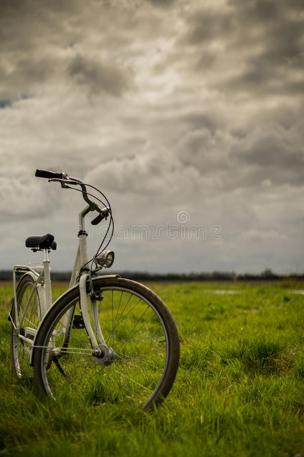 Bike standing in the meadows - portrait stock photography