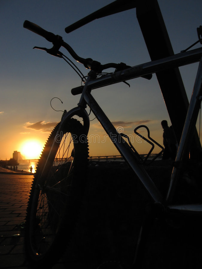 Bike on the sunset royalty free stock photo