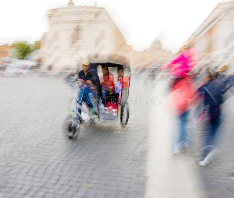 Bike taxi rushing on the street in intentional motion blur royalty free stock photos