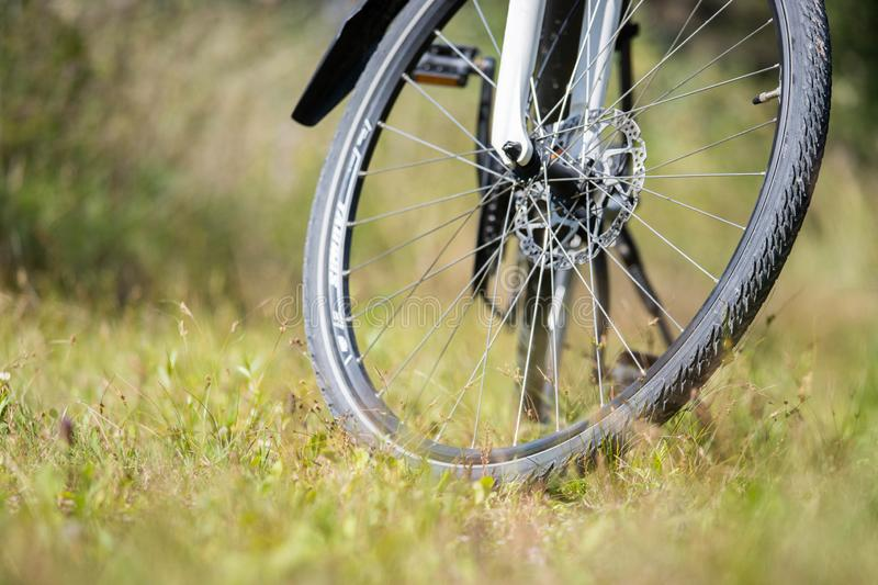 Bike tour, tyre of a bike outdoors, text space. Bike tour. Bike, grass and wood. Outdoors, text space adventure trip active bicycle safety tire cycling nature royalty free stock photos