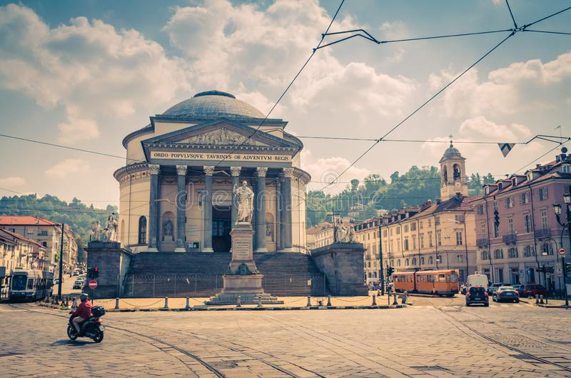 Bike and trams ride on square piazza in front of Catholic Parish Church Chiesa Gran Madre Di Dio neoclassic style building and Vit stock images