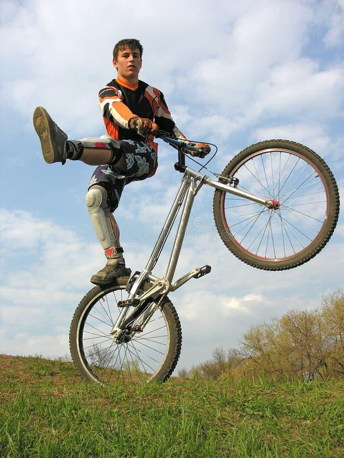 Download Bike trick 2 stock photo. Image of cloud, jump, control - 1705464