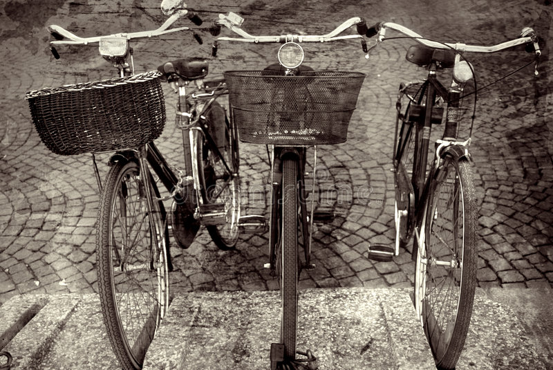 Bike Trio in Italy. Three bikes in Italy parked outside cafe stock photo