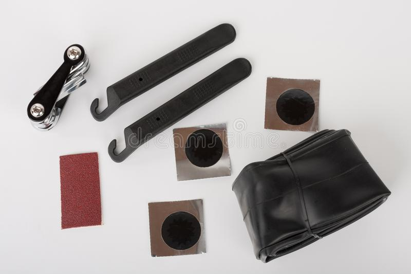 Bike tyre tube puncture repair tool kit. Set of tools for repairing punctured tube, on white background, studio photo royalty free stock photography