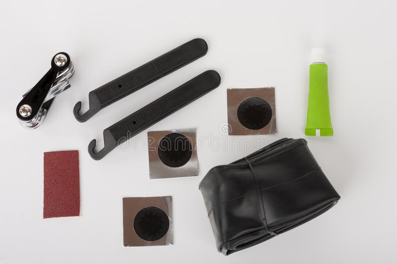 Bike tyre tube puncture repair tool kit. Set of tools for repairing punctured tube, on white background, studio photo stock photos