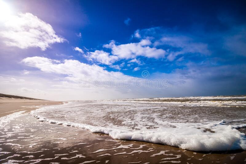 Bike Waves of Sea Under Clouded Blue Sky during Daytime stock images