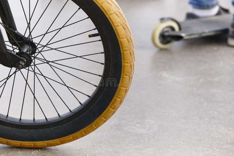 Bike wheel detail and skate. Sport background. stock photo