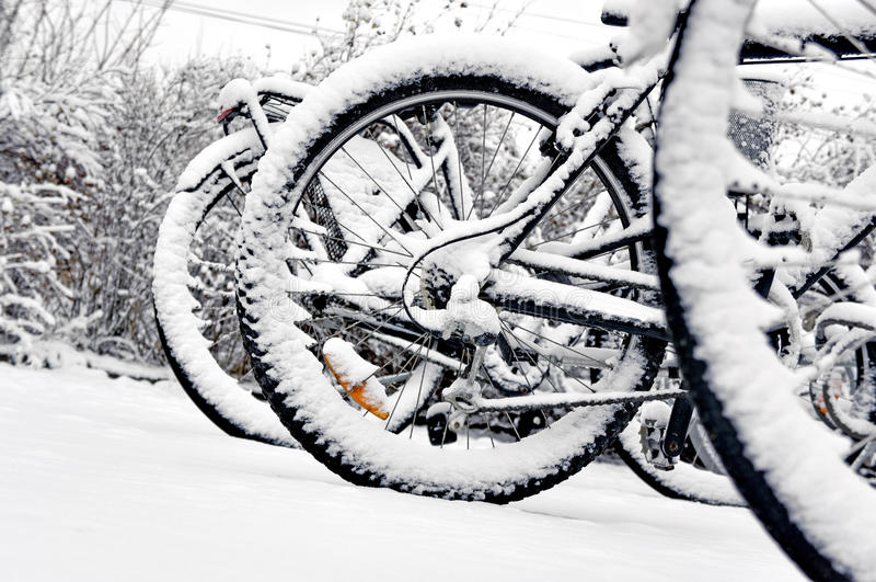 Bike wheel in winter. Close up of wheel of bike in bicycle rack in winter stock images
