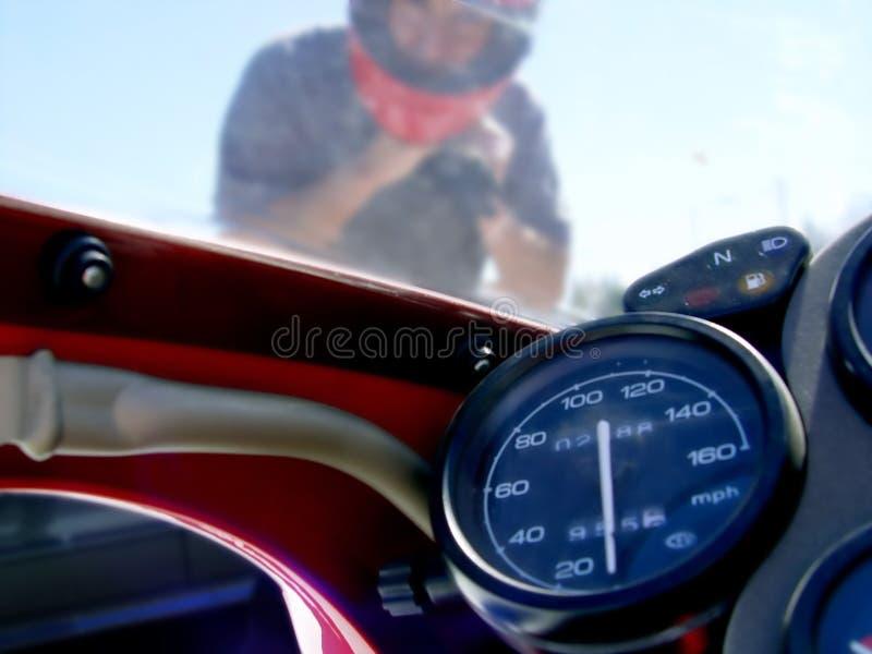 Biker 1. Man on the red bike royalty free stock photos