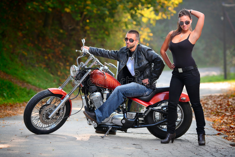 Biker and an attractive girl stock photo
