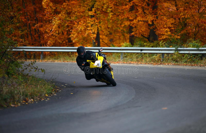 Biker in autumn royalty free stock images