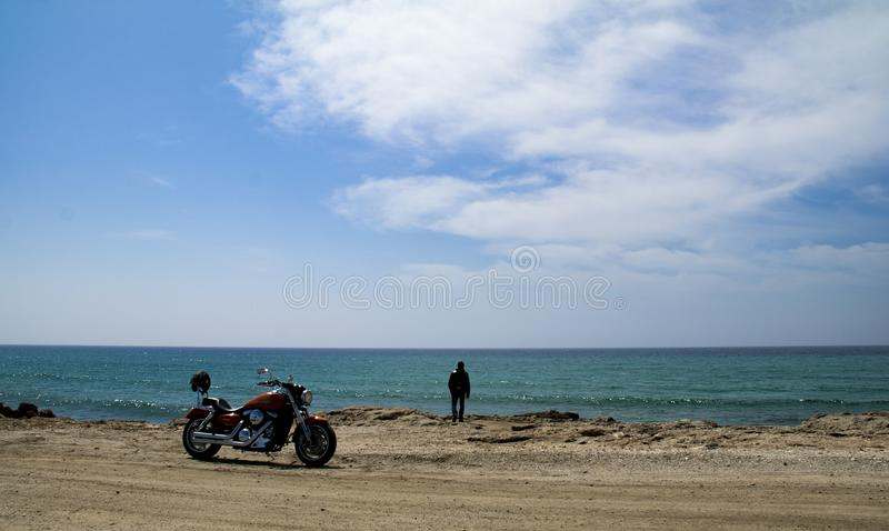 Biker on the beach royalty free stock image
