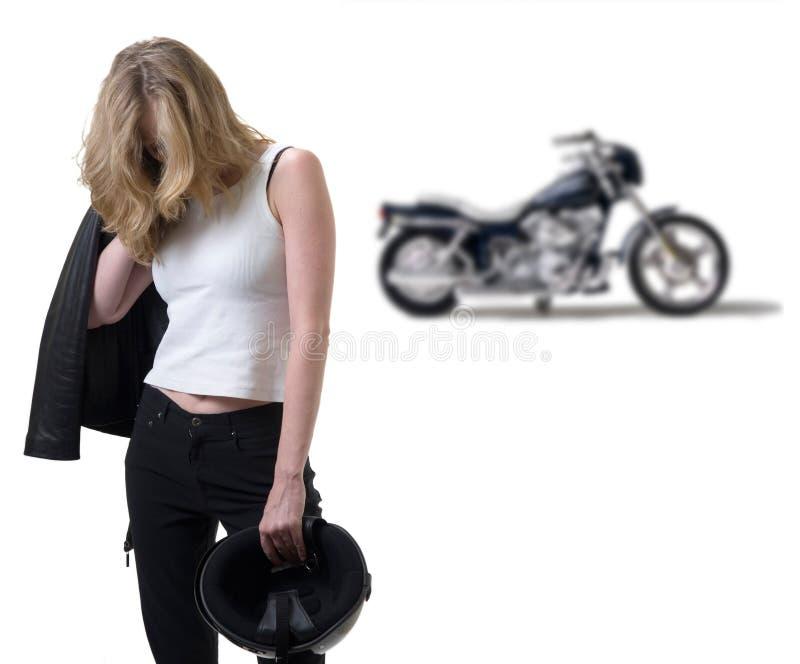 Biker blues. Blonde biker woman with head down