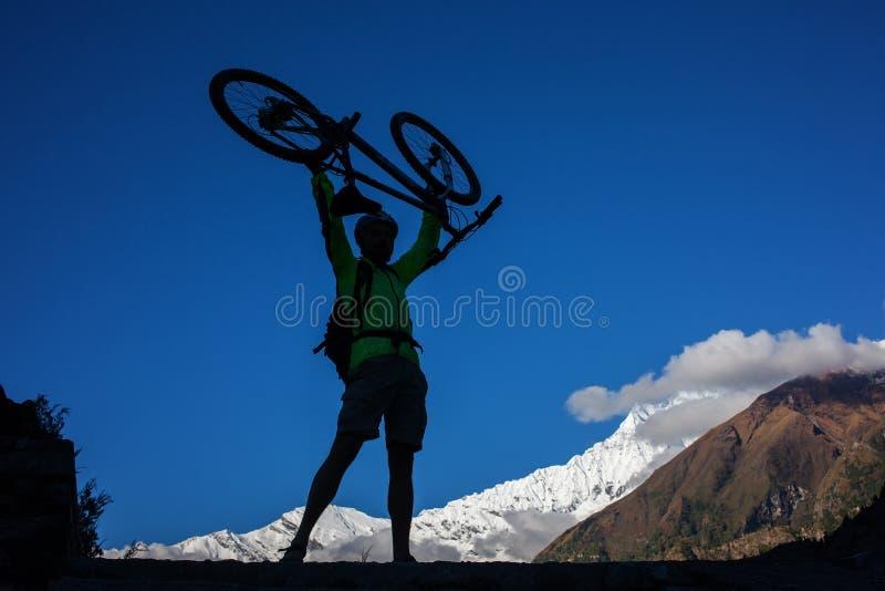 Biker-boy in Himalaya mountains, Anapurna region.  royalty free stock photo