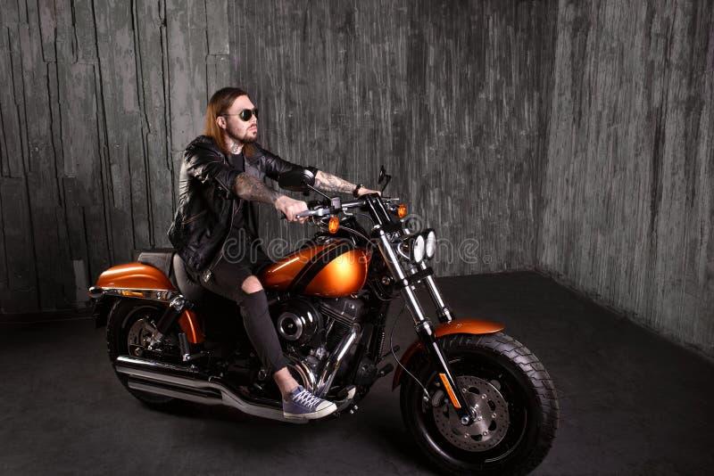 Biker caucasian man sitting on motorbike. Portrait of handsome biker caucasian man sitting on motorbike stock photos
