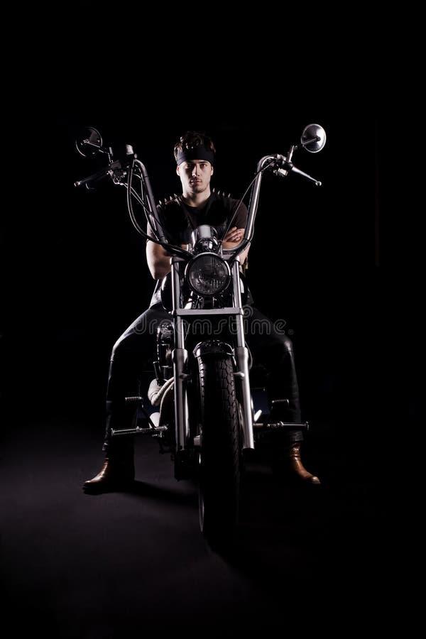 Biker on chopper motorcycle stock photo
