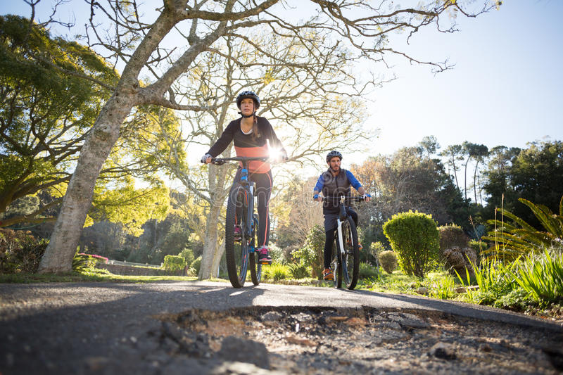 Biker couple cycling on the countryside road stock photo