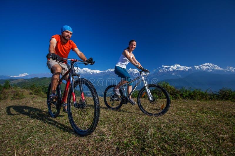 Biker family in Himalaya mountains. Anapurna region royalty free stock photography