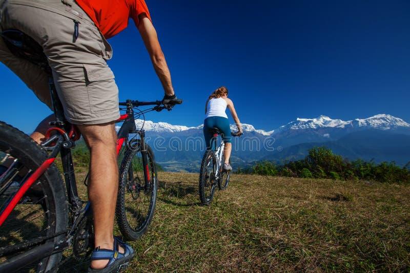 Biker family in Himalaya mountains. Anapurna region royalty free stock images