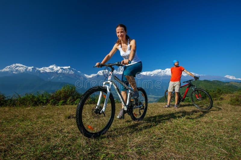 Biker family in Himalaya mountains. Anapurna region stock photos