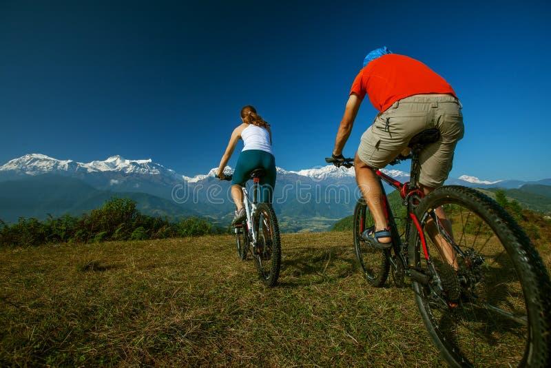 Biker family in Himalaya mountains. Anapurna region stock photography