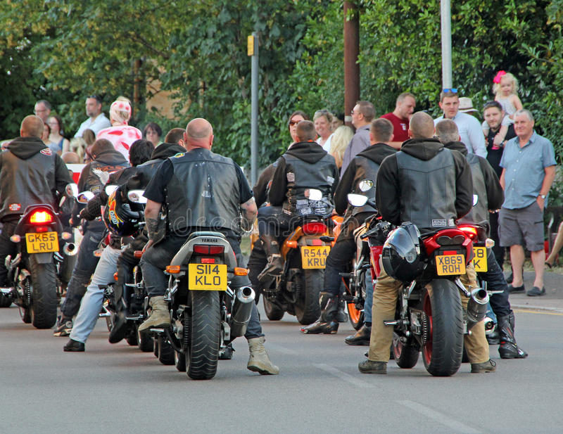 Biker gang. Photo of gang of bikers travelling down the high street in whitstable kent during carnival time 6th august 2016.ideal for street gangs,bikers etc royalty free stock images