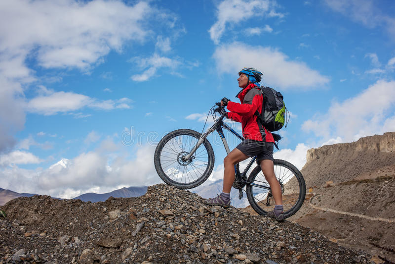 Biker-girl in Himalaya mountains. Anapurna region stock photos