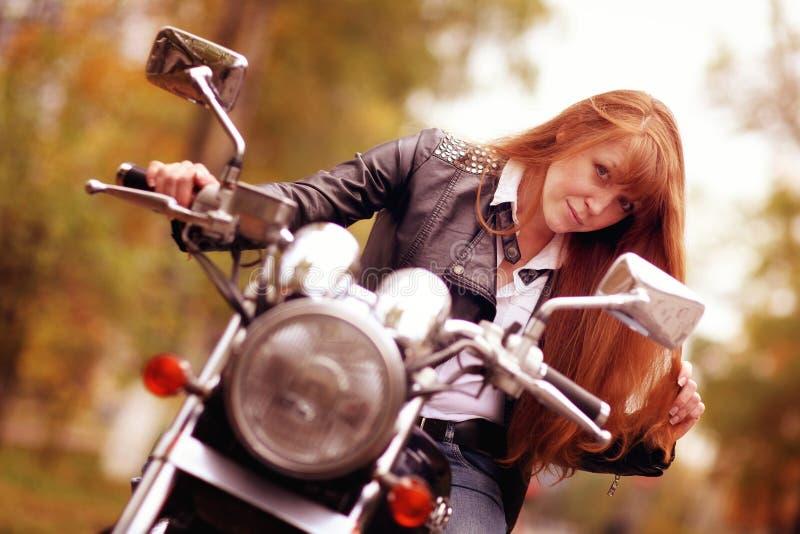 Biker girl on motorcycle stock image