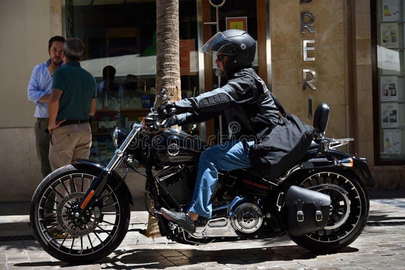 Biker on Harley in Malaga. royalty free stock image