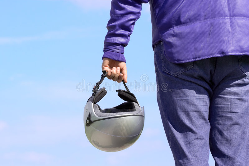 Biker holding a helmet royalty free stock photography