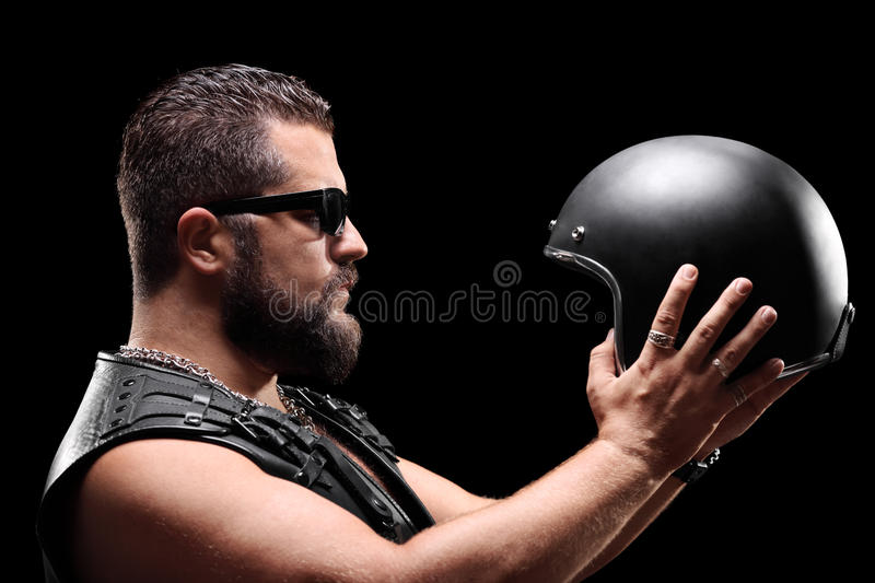 Biker holding a helmet royalty free stock photo