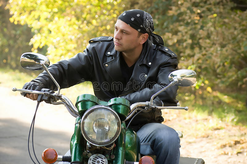 Download Biker man sits on a bike stock photo. Image of background - 27175990