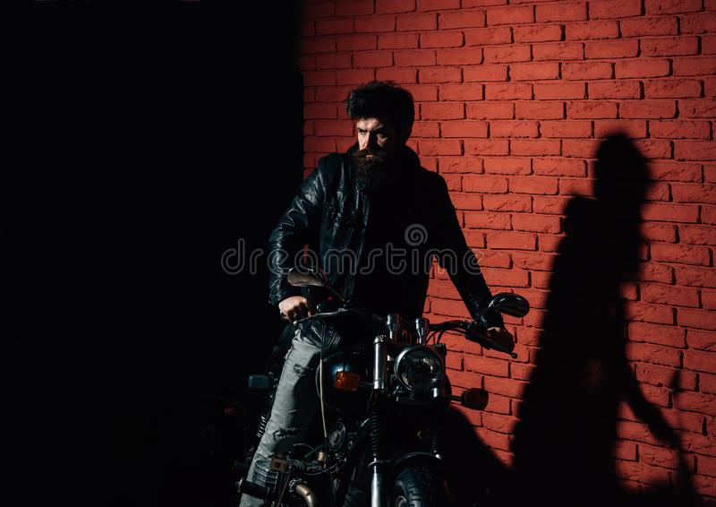 Biker party. biker party poster with bearded biker. motor party with hipster man on motorbike. man going on biker party stock photo