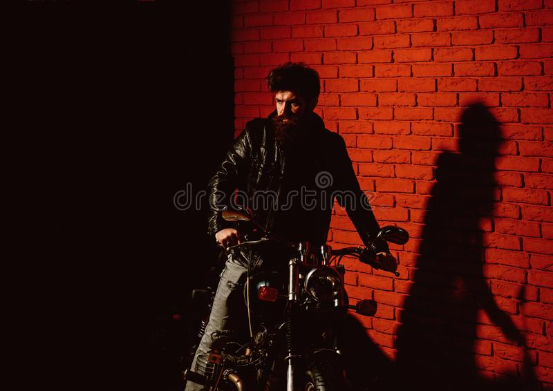 Biker party. biker party poster with bearded biker. motor party with hipster man on motorbike. man going on biker party. Dangerous royalty free stock image
