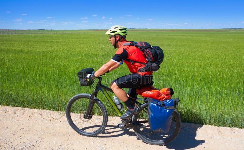 Biker pilgrim by Camino de Santiago stock photo