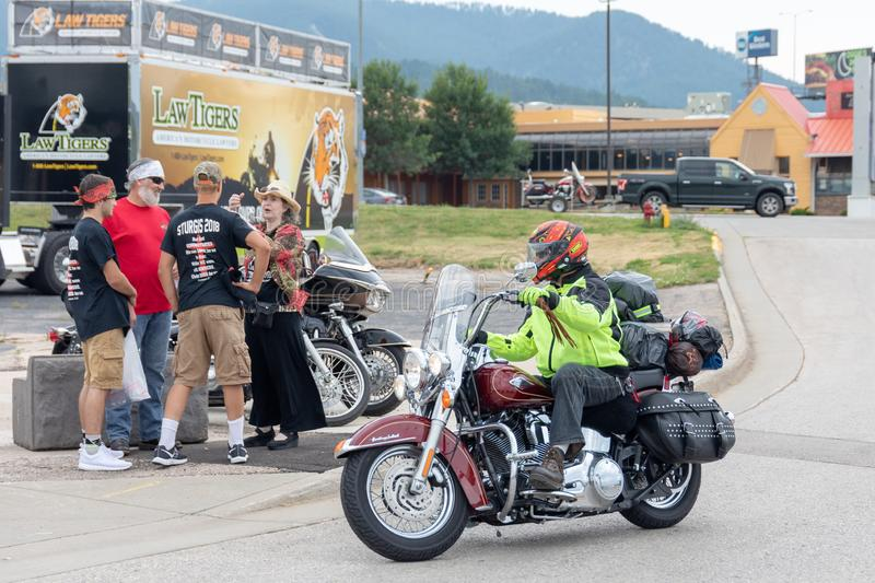 Biker rides into town for Sturgis Motorcycle Rally. SUNDAY, AUGUST 5, 2018, STURGIS, SD: One of the many tens of thousands of bikers to ride into Sturgis, South stock photos