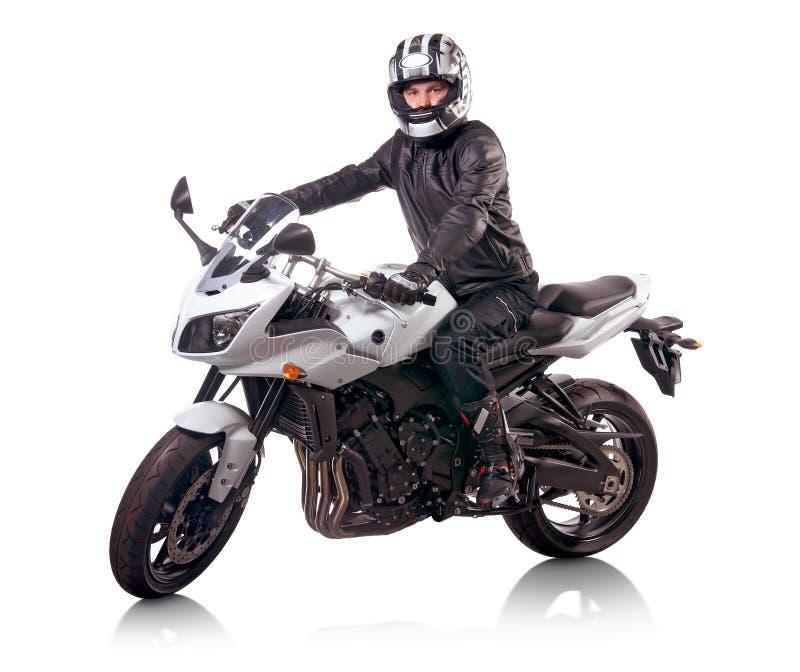 Biker rides white motorcycle royalty free stock images