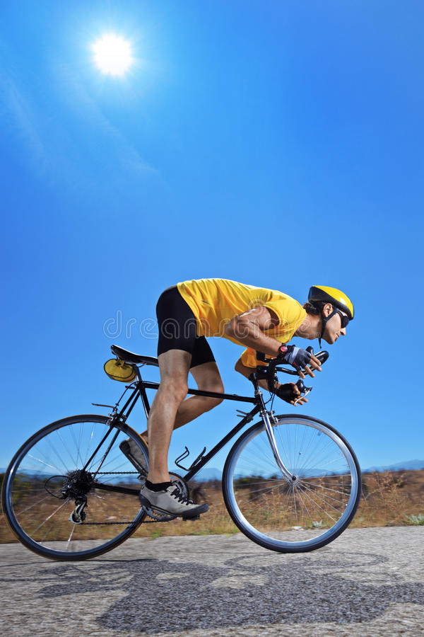 Download Biker  Riding A Bike On An Open Road Stock Image - Image: 16016615