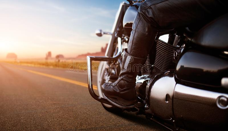 Biker riding on chopper, view from rear wheel royalty free stock images