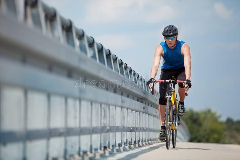 Biker riding on race road bike stock photography