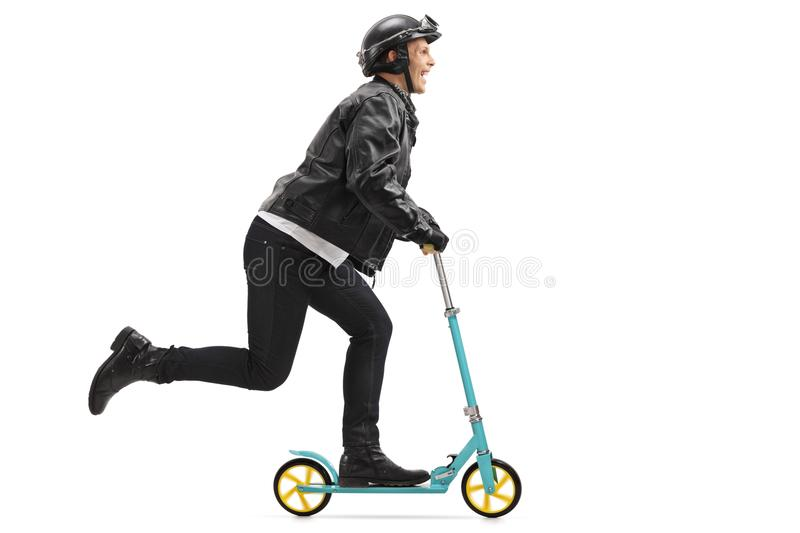 Biker riding a scooter royalty free stock image
