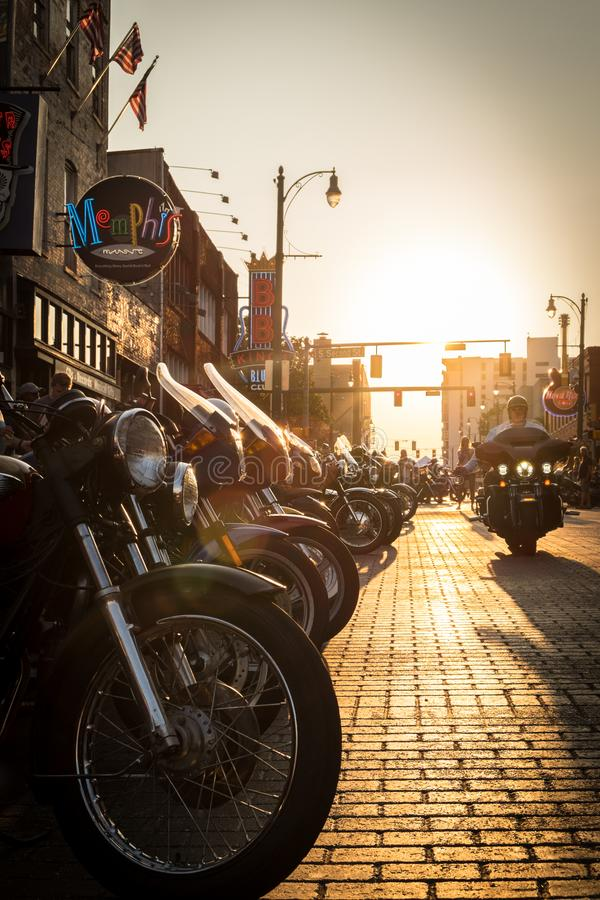 Biker riding on Beale street, Memphis. Biker riding at sunset on Beale street, Memphis, United States of America royalty free stock image