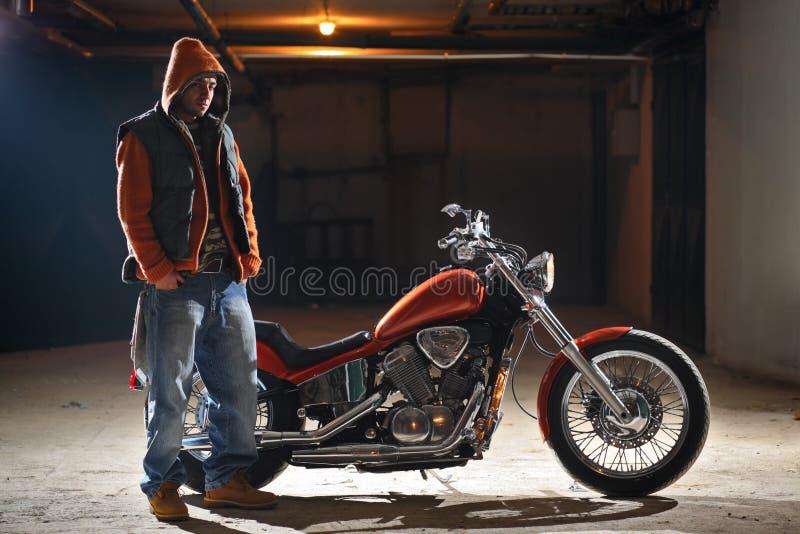 Download Biker Standing Next To A Bike Stock Photos - Image: 4016883