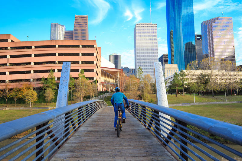Biker on the street in Houston Texas Skyline with modern skyscrapers and blue sky view from park stock photo