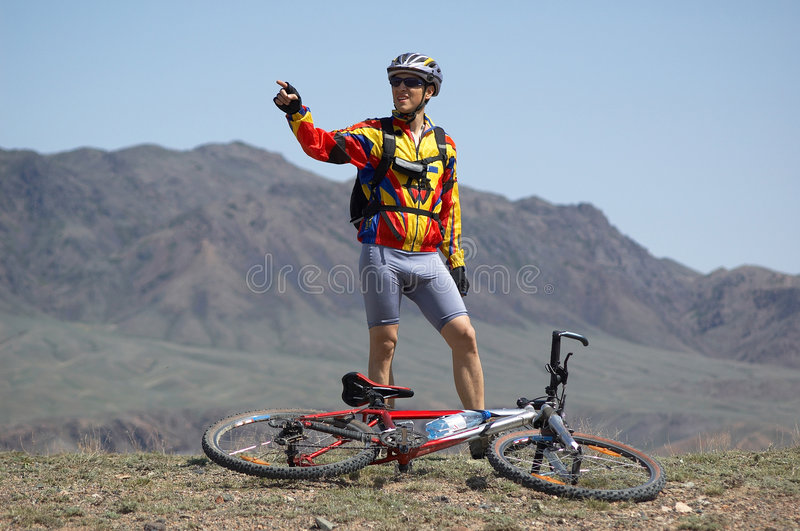 Biker to show the way royalty free stock images