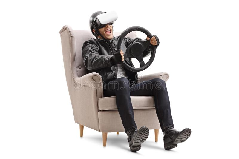 Biker using a VR headset and holding a steering wheel royalty free stock photography