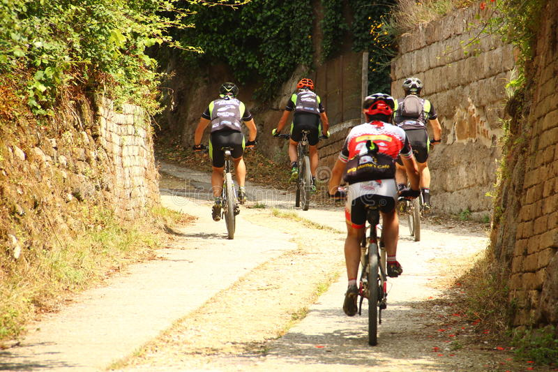 Bikers at Blera, Italy. The picture shows bikers cycling at Blera, a little town in northern Lazio, Italy royalty free stock images
