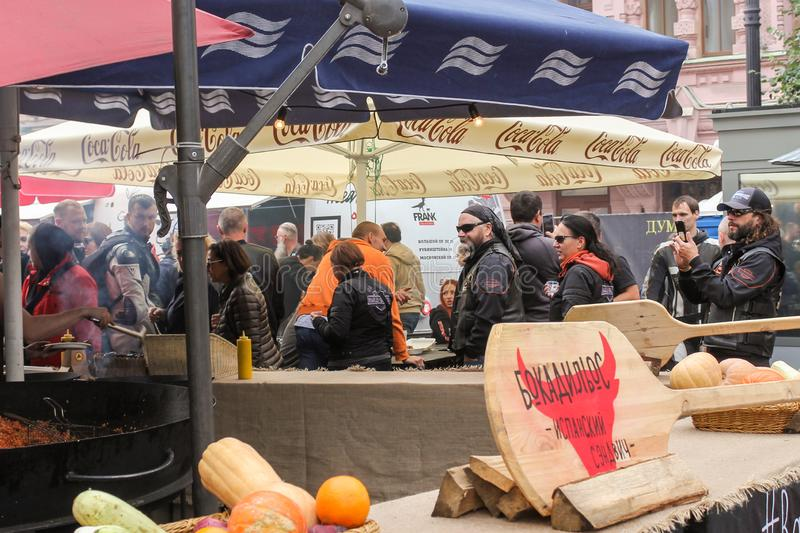 Bikers in the food area of the festival royalty free stock images